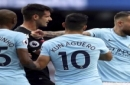 Crystal Palace's Scott Dann, second left and Manchester City's Nicolas Otamendi, right, react, during the English Premier League soccer match between Manchester City and Crystal Palace, at the Etihad Stadium, in Manchester, England, Saturday, Sep