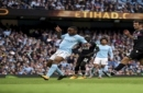 Manchester City's Raheem Sterling, centre, scores his side's third goal of the game, during the English Premier League soccer match between Manchester City and Crystal Palace, at the Etihad Stadium, in Manchester, England, Saturday, Sept. 23, 201