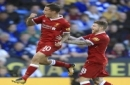Liverpool's Philippe Coutinho, left, celebrates scoring his side's first goal of the game during the Premier League soccer match. Leicester City versus Liverpool at the King Power Stadium, Leicester, England, Saturday Sept. 23, 2017. (Mike Egerto
