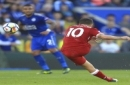 Liverpool's Philippe Coutinho scores his side's first goal of the game during the Premier League soccer match. Leicester City versus Liverpool at the King Power Stadium, Leicester, England, Saturday Sept. 23, 2017. (Mike Egerton/PA via AP)