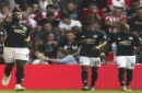 Manchester United's Romelu Lukaku, left, celebrates scoring his side's first goal of the game during their English Premier League soccer match against Southampton at St Mary's Stadium, Southampton, England, Saturday, Sept. 23, 2017. (Andrew Ma