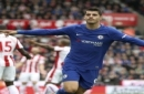 Chelsea's Alvaro Morata celebrates scoring his side's first goal of the game during the English Premier League soccer match between Stoke City and Chelsea at the bet365 Stadium, Stoke-on-Trent, England, Saturday, Sept. 23, 2017. (Nigel French/PA v