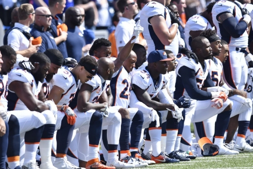 Thirty-two Broncos choose to kneel during national anthem