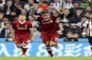 Liverpool's Philippe Coutinho celebrates scoring his side's first goal of the game during the English Premier League soccer match against Newcastle United at St James' Park, Newcastle, England, Sunday, Oct. 1, 2017. (Owen Humphreys/PA via AP)