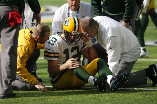 Aaron Rodgers hurts shoulder weeks before matchup with the Lions