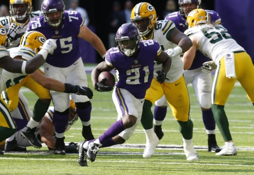 With Aaron Rodgers out, Vikings cruise past Packers