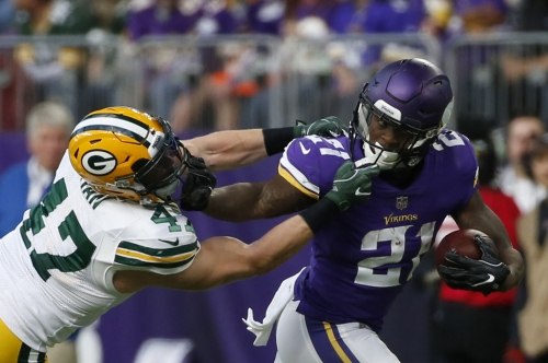 With Rodgers out, Vikings cruise past Packers 23-10