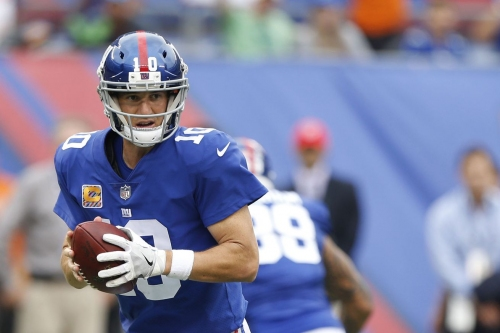 Eli Manning hears trade speculation, but intends to remain a Giant