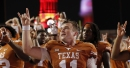 Sam Ehlinger showered with 'Texas sucks' chants, throws up horns