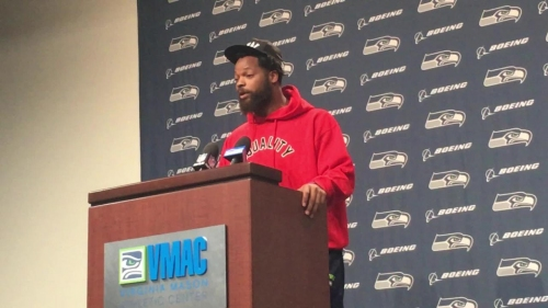 Seahawk Michael Bennett says he will keep sitting for anthem, says Colin Kaepernick needs a job in NFL before there can be dialogue between players and owners