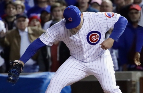 Baez breaks out with 2 HRs, Davis guts 6-out save as Cubs stay alive