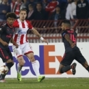 Red Star's Milan Rodic, center, challenges for the ball with Arsenal's Reiss Nelson, left, and Theo Walcott during the Europa League group H soccer match between Red Star and Arsenal on the stadium Rajko Mitic in Belgrade, Serbia, Thursday, Oct. 1