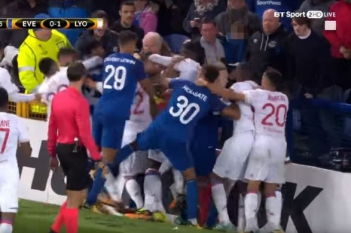 Disbelief as Everton fan appears to swing at Lyon players - while carrying a child