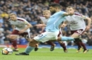 Manchester City's Sergio Aguero scores from the penalty spot during the English Premier League soccer match between Manchester City and Burnley at Etihad stadium, Manchester, England, Saturday, Oct. 21, 2017. (AP Photo/Rui Vieira)