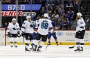 Sharks waste Couture's hat trick in loss to Islanders