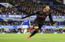 Arsenal's Mesut Ozil celebrates scoring his side's second goal against Everton during the English Premier League soccer match against Arsenal at the Goodison Park, Liverpool, England, Sunday Oct. 22, 2017. (Peter Byrne/PA via AP)