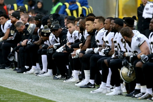 About 2 dozen NFL players protested during national anthems Sunday