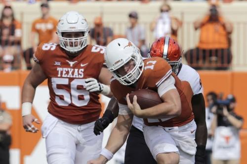 Texas QB Sam Ehlinger, C Zach Shackelford miss practice due to head injuries