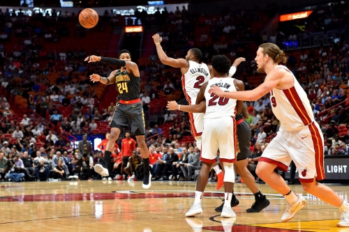 Heat hang on to beat Hawks 104-93