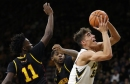 Hawkeyes get rolling late to avoid upset