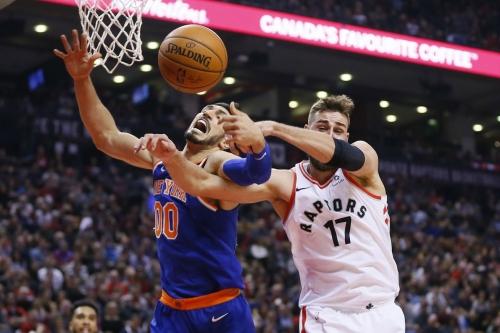 Raptors 107, Knicks 84: Scenes from Kristaps Porzingis' swollen elbow