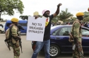 Zimbabweans say Mugabe must quit now, but more talks planned