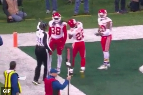 Marcus Peters threw the ref's flag into the stands, left game