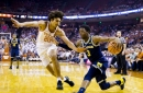 Michigan fends off obstacles, takes down Texas on the road