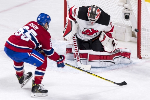 Scrappy Devils fall in overtime in Montreal