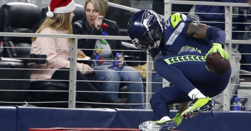 Seahawks' Justin Coleman gets pick-six, celebrates by jumping in a Salvation Army kettle