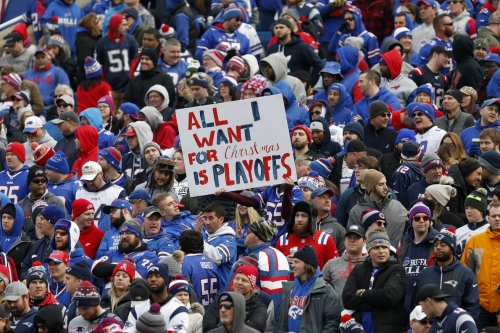 Buffalo Bills fans greet team at airport after they make the postseason in Miami