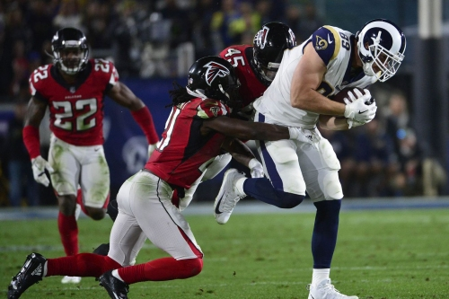With lousy fields and poor calls, the NFL continues to wreck its own playoff product