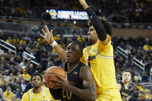 Isaiah Livers suffers ankle injury early against Northwestern