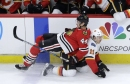After further reviews, Blackhawks suffer costly loss to Flames