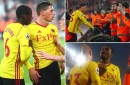 Watford's Christian Kabasele and Jose Holebas clash with their own fans