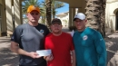 Dolphins coaches, staff donate $17,500 to family of Douglas coach Aaron Feis, killed in school shooting