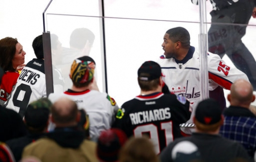 Blackhawks ban 4 from home games due to racist taunt