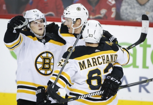 Bruins 2, Flames 1 (OT): Brad Marchand helps B's douse Flames