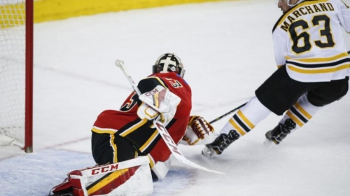Marchand scores in overtime, Bruins beat Flames 2-1