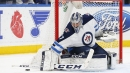 Connor Hellebuyck makes 34 saves, Jets shut out Blues
