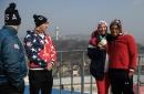 Olympic bobsledder Lauren Gibbs lets Ivanka Trump try on her silver medal
