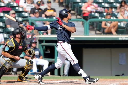 Infield leads the way as Braves avoid capsizing to Pirates in 7-5 Spring win