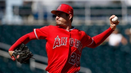 Pujols' first hit of the spring helps Angels to a 7-5 victory over the Reds