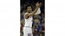 Top-seeded Kansas comes alive, beats Penn 76-60 in NCAAs