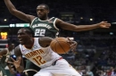 Giannis' double-double helps Bucks hold on to beat Hawks