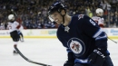 Jets' Trouba leaves game vs. Stars after big collision with Benn