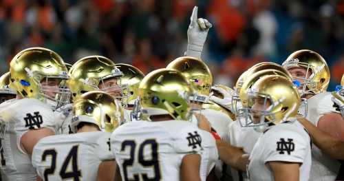 Notre Dame offensive coordinator Chris Long says compete level is higher than last season's Fighting Irish