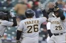 Replay review helps Pirates beat Tigers 13-10 in 13 innings