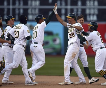 A's beat White Sox in 14-inning, nearly 6-hour game