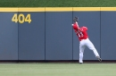 Cincinnati Reds manager Jim Riggleman to stick with four-man outfield rotation – for now